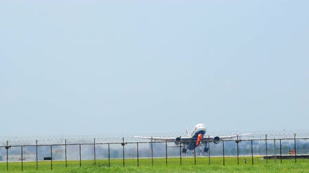 Closeup of the airplane that was takeoff from the runway in the airport up on the sky.