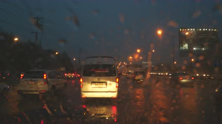 traffic bucharest : Bangkok,Thailand-July 6,2017: Drive in heavy rain and dark while flooding in the street special caution should be exercised, as it may cause accidents.