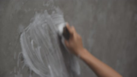 Womans hand used to convert polishing cleaning on the concrete wall. Stock Footage