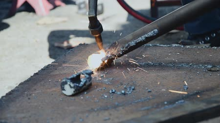 welding torch : The technician in an industrial factory is cutting steel with gas.