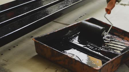 Rolling steel painted in the painted tray with black color. pan, salver, tray Stock Footage