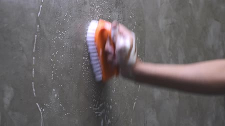 mold : Mens hands are used to convert polishing cleaning on the concrete wall. Stock Footage