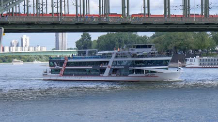 kolínská voda : Cologne, Germany - September 21, 2015: This is a quay view of Rhine river and Hohenzollern railway bridge in Cologne, Germany