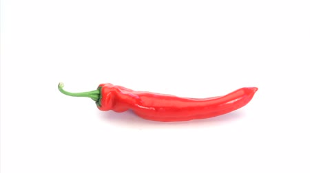 перец чили : Red pepper rotating on a white background