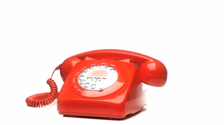 telefones : Red fixed phone rotating on a white background