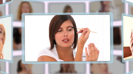 косметика : Montage of good looking women puting make-up on in a studio Стоковые видеозаписи