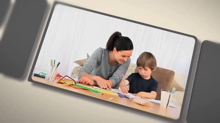 segít : Montage of children doing their homework with their parents at home Stock mozgókép