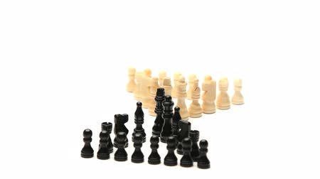 conflict : White chess pieces facing black chess pieces rotating on a white background Stock Footage