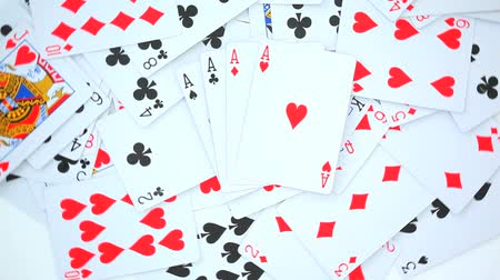 kart : Playing cards rotating on a white background