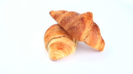 kruvasan : Croissants rotating on a white background