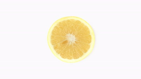 lemoniada : Half a lemon rotating on a white background Wideo