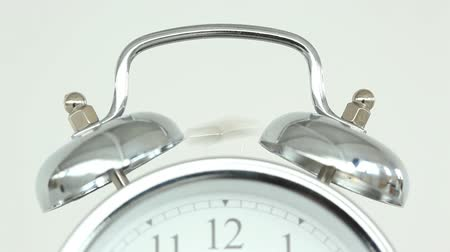 morning : Clock ringing against a white background Stock Footage