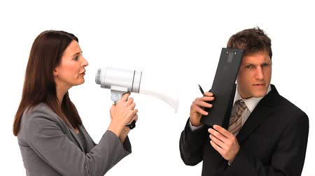 партнеры : Businesswoman giving orders through a megaphone next to a man  Стоковые видеозаписи