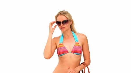 tonları : Wonderful blonde woman with sunglasses in swimsuit during the vacation