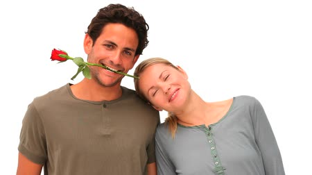 dış : Handsome man with rose between his teeth next to his wife Stok Video