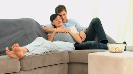 koca : Lovely future parents on their sofa