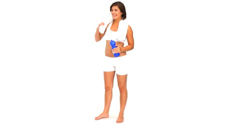 toalhas : Brunette drinking water after sport against a white background