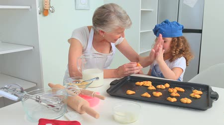 mutfak malzemesi : Grandmother and grand daughter proud of what they cooked