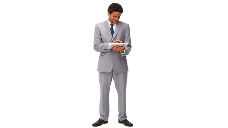 spojení : Elegant business man using a touch pad isolated on a white background