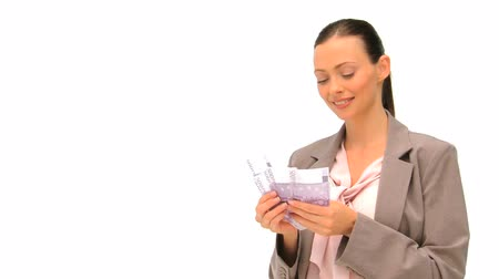 gotówka : Happy businesswoman holding her cash against a white background