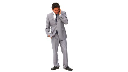 gergin : Elegant businessman getting nervous on the phone isolated on a white background