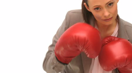 luva : Woman with boxing gloves dressing in a formal suit Stock Footage