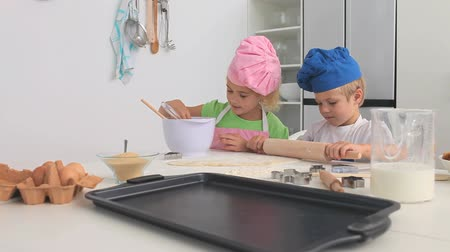 adorable : Brother and sister cooking together in the kitchen