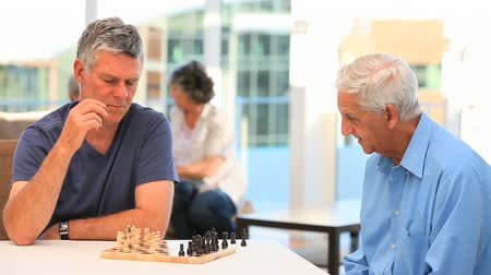 senior lifestyle : Friends playing chess