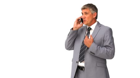 dedo : Middle aged businnessman speaking on the phone
