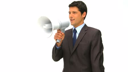 определение : Businessman speaking through a megaphone isolated on a white background