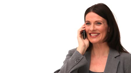 kanapa : Brown-haired woman laughing on the phone isolated on a white background