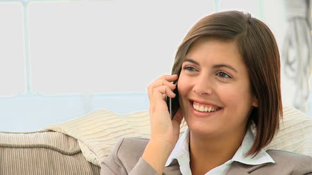 брюнет : Cute brunette having a phone call at home