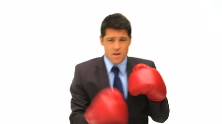 homem de negócios : Man dressing in a business suit with boxing gloves against a white background Vídeos
