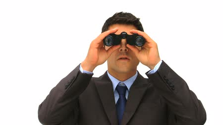 boss : Businessman looking for someone with a pair of binoculars Stock Footage