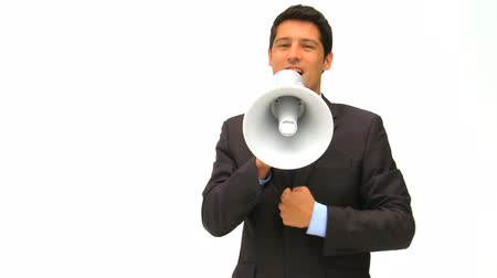 atenção : Man shouting through a megaphone isolated on a white background Vídeos