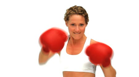 yarışma : Dynamic blonde woman with boxing gloves isolated on a white background Stok Video