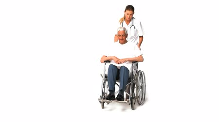 stáří : Nurse with her male patient in wheelchair Dostupné videozáznamy