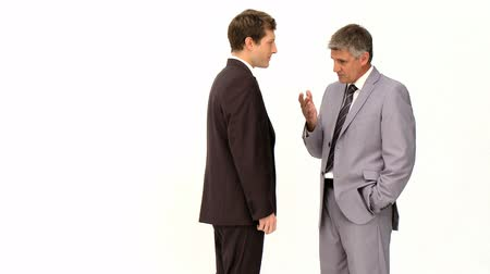 two people talking : Two businessmen speaking isolated on a white background