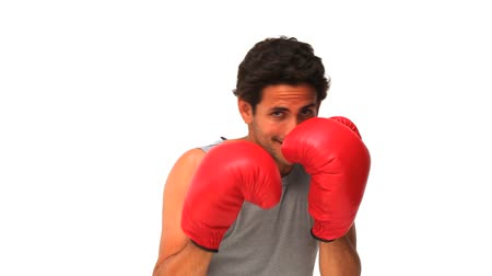 sportovní : Handsome man with red boxing gloves isolated on a white background