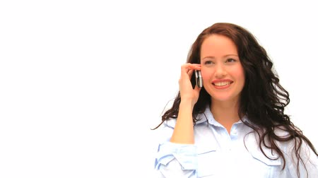 брюнет : Casual woman speaking on the phone isolated on a white background