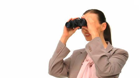segredo : Woman looking through binoculars against a white background