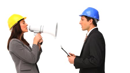 biztonság : Business people with safety helmets and megaphone