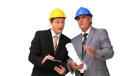 two people talking : Architects speaking about a building project isolated on a white background