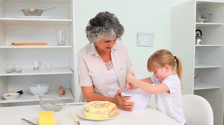 cooks : Girl baking with her Grandmother Stock Footage