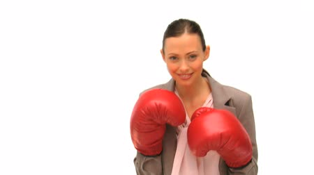 boxe : Brunette lady with boxing gloves isolated on a white background