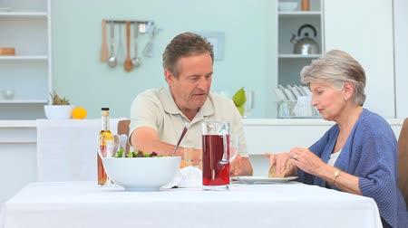 meal : Elderly couple during the lunch time in the dinning room Stock Footage