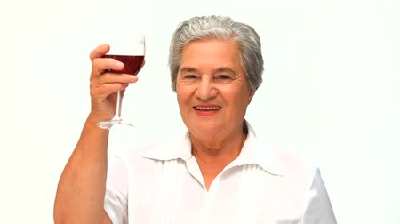 senior lifestyle : Woman drinking some red wine Stock Footage