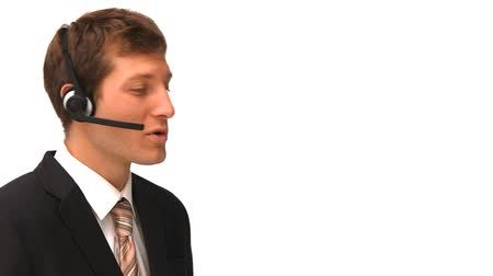 temsilci : Young businessman speaking over the headset against a white background