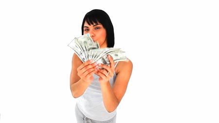 gotówka : Attractive asian showing off her cash isolated on a white background Wideo