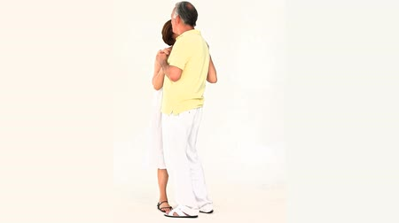 мебель : Elderly couple dancing againsta white background Стоковые видеозаписи